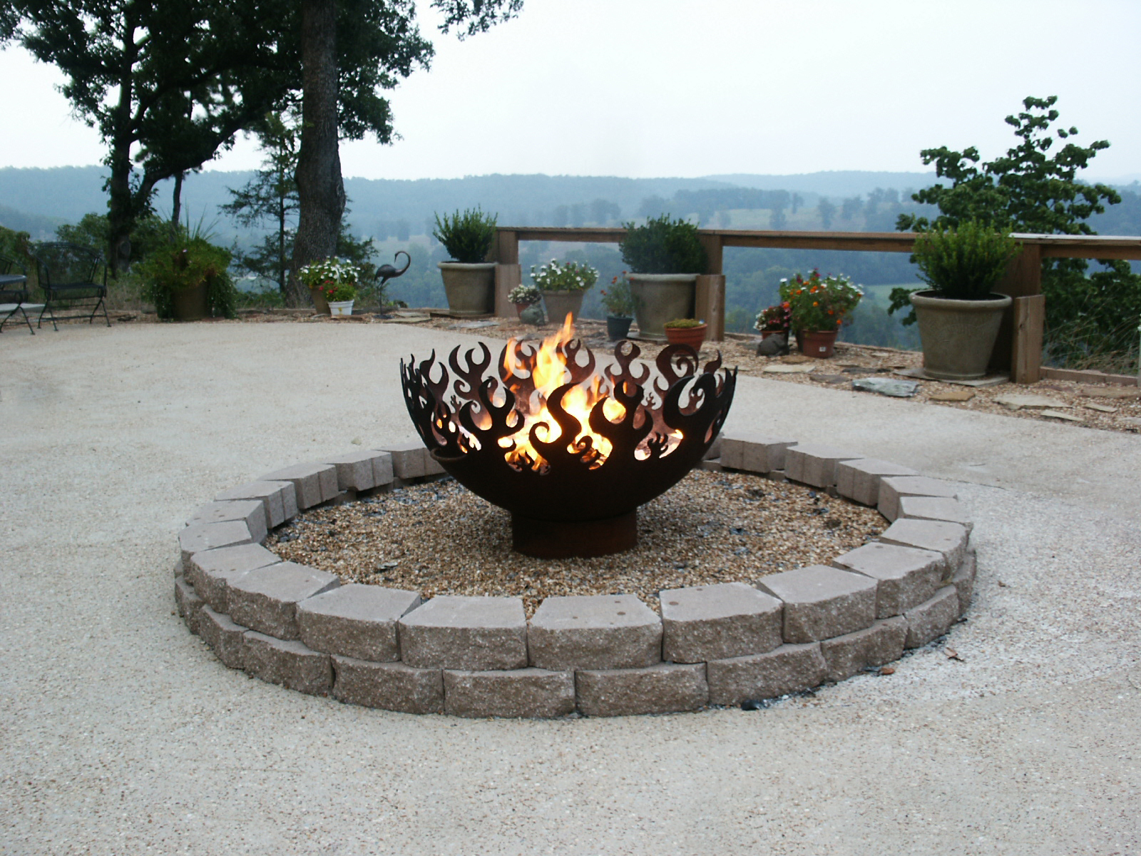 Great Bowl O' Fire 41 Inch Sculptural Firebowl™ overlooking river in Norfolk, AR