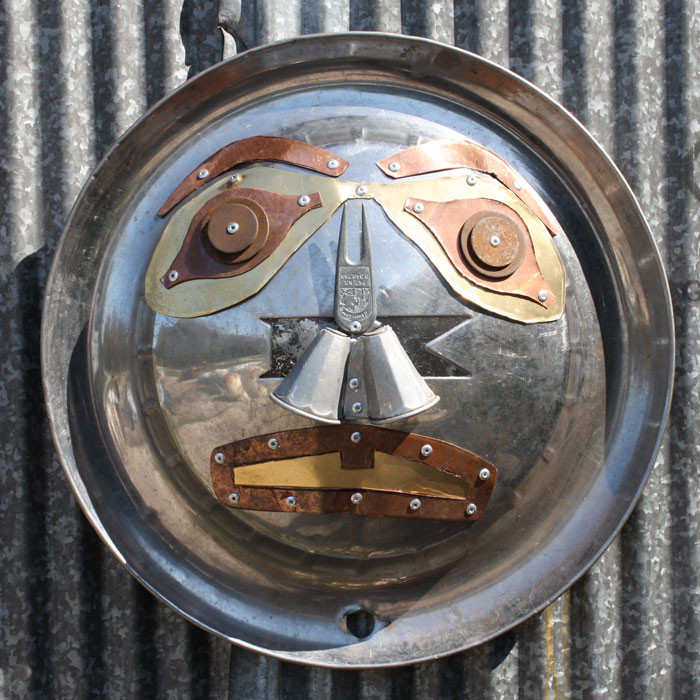 Hubcap mask for landfill art show