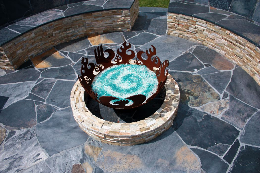Galveston Bay firebowl enclosed stone patio with built in seating