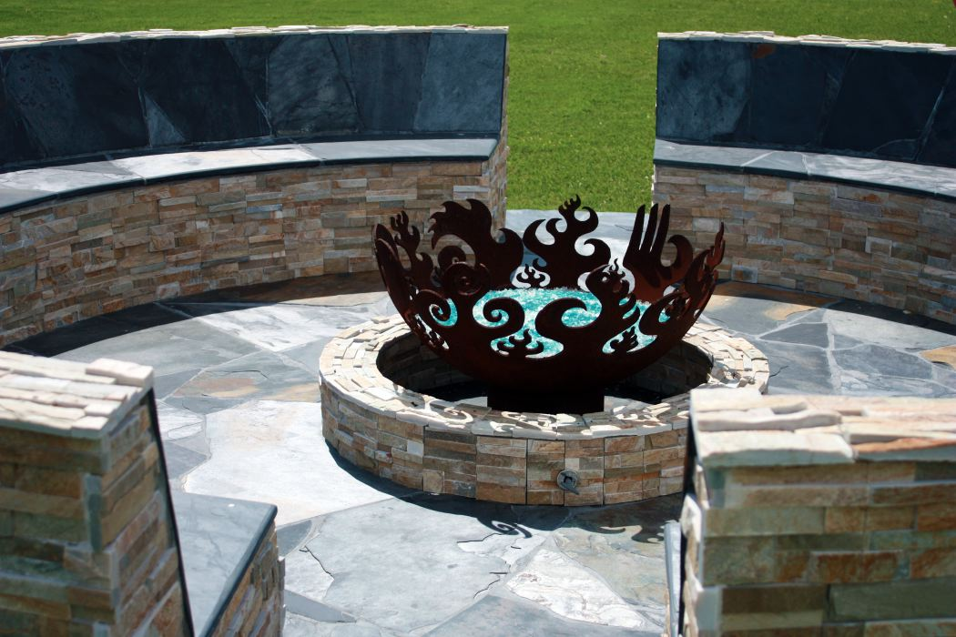 Masonry benches enclosing patio with firebowl