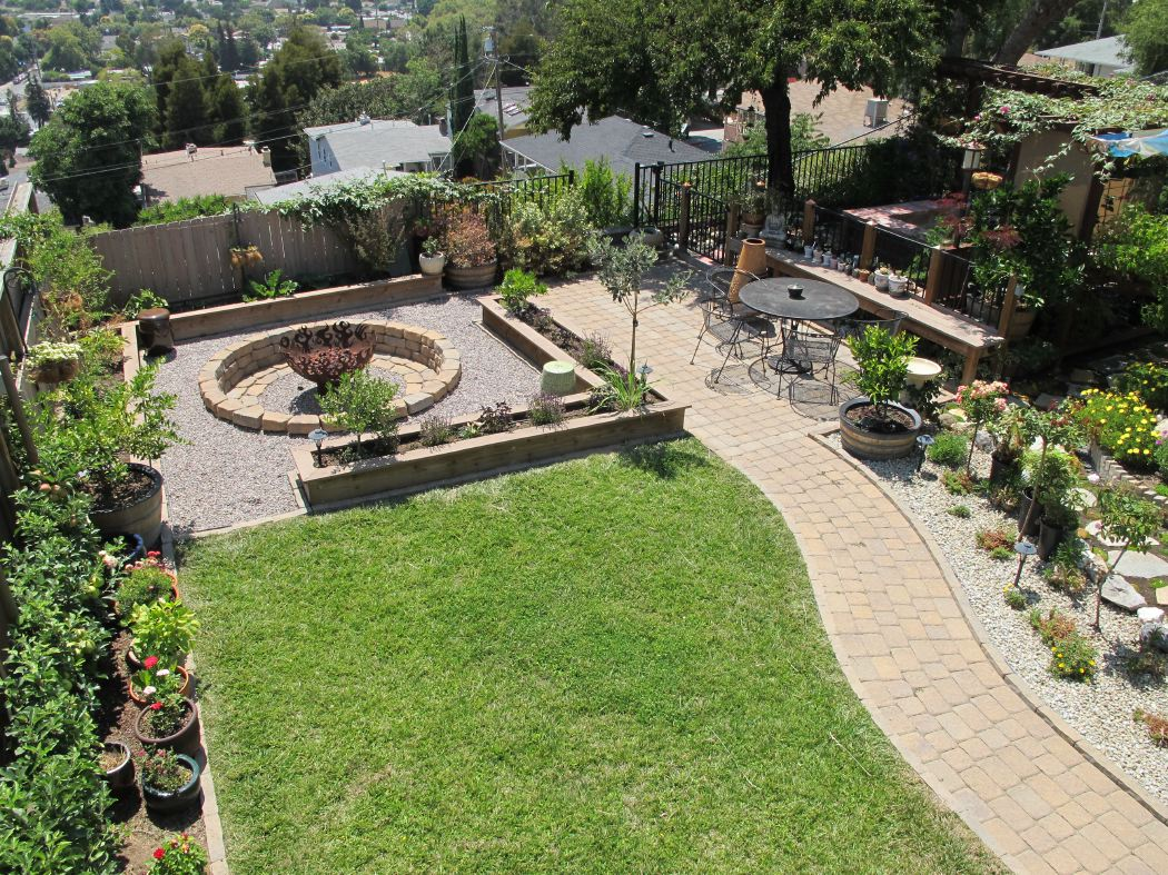 Firebowl with patio, planters seating and garden path