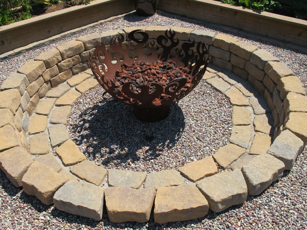 Inset limestone blocks around firebowl