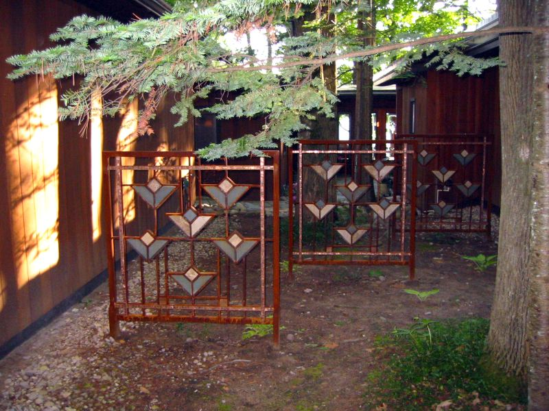 Frank Lloyd Wright Styled Fence in Steel, Slate, Copper + Glass
