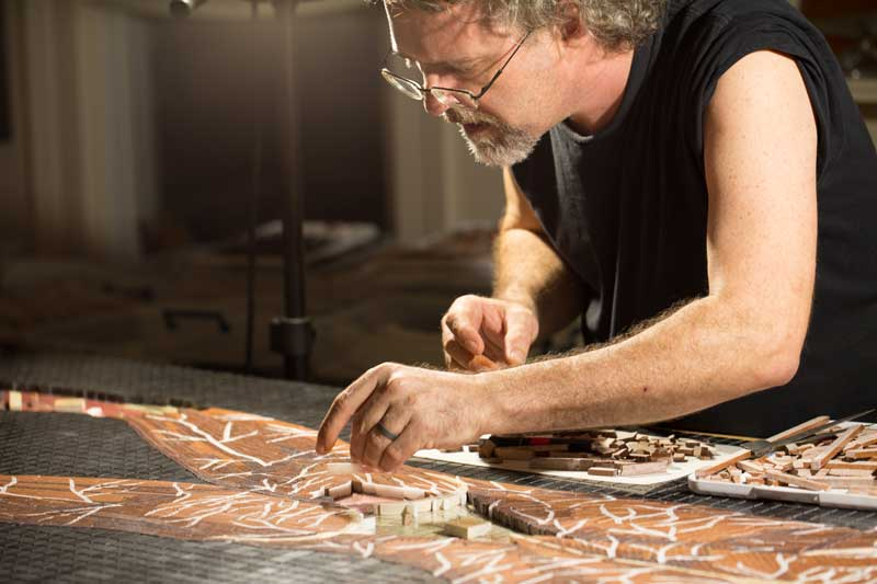 John T. Unger at work on marble mosaic
