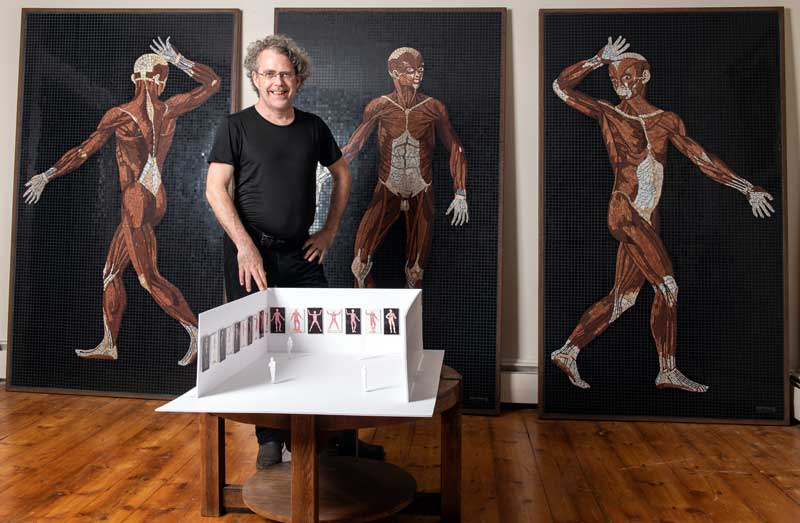 Artist John T. Unger with three completed mosaics and exhibition maquette