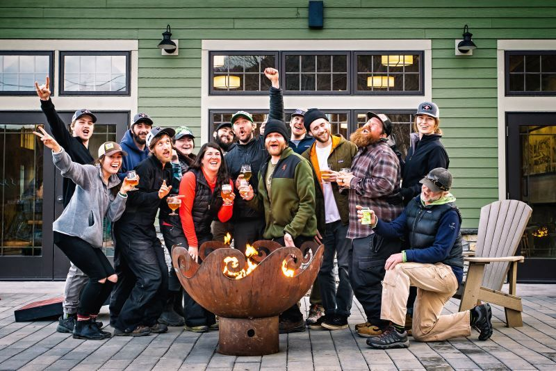 The staff gathers around a 41 inch Waves O' Fire Sculptural Firebowl at Lawsons Finest Brewery and Taproom, Waitsfield, VT